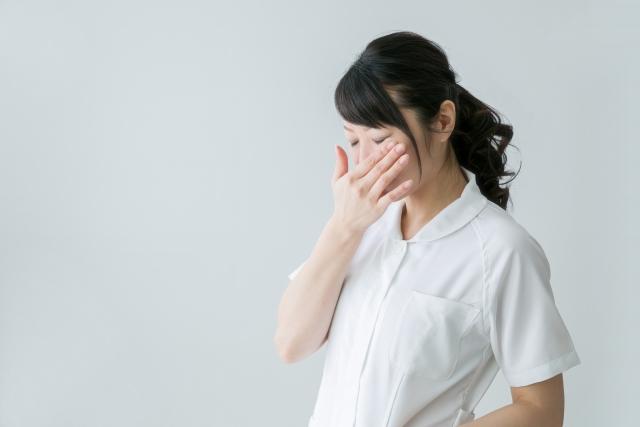 ストレスで悲しむ看護師